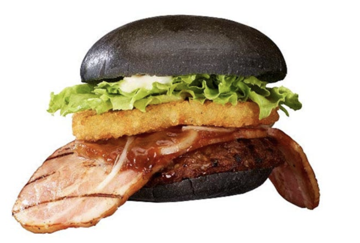 <p>OK, ready for this? Slapped between the two black buns of Burger King's Kuro Ninja Burger is a list of ingredients that include a single beef patty, a hash brown, garlic soy sauce, onion, and lettuce. But let's not forget about the massive slice of thick bacon that is made to resemble a ninja sticking out its tongue. Clever marketing, BK.</p>