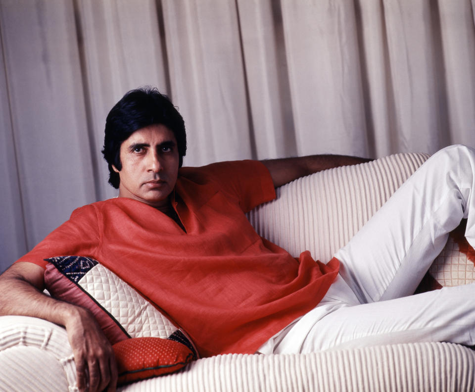 1987, India, Portrait of Amitabh Bachchan sitting on sofa. (Photo by Dinodia Photos/Getty Images)