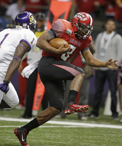 Louisiana-Lafayette quarterback Terrance Broadway (8) scores a touchdown as East Carolina defensive back Chip Thompson (1) defends in the first half of the New Orleans Bowl, an NCAA college football game in New Orleans, Saturday, Dec. 22, 2012. (AP Photo/Dave Martin)
