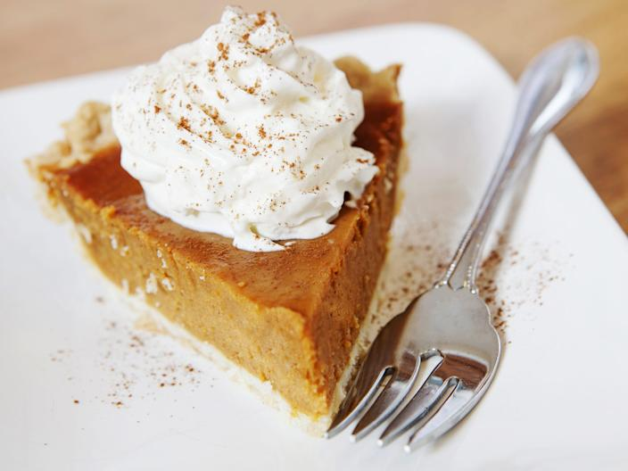pumpkin pie slice whipped cream fork