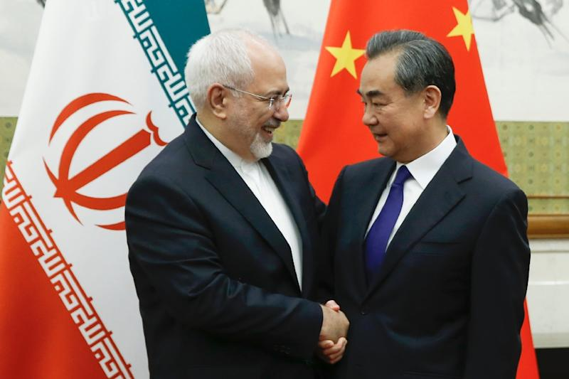 Chinese Foreign Minister Wang Yi met his Iranian counterpart Mohammad Javad Zarif earlier this week (AFP Photo/THOMAS PETER)