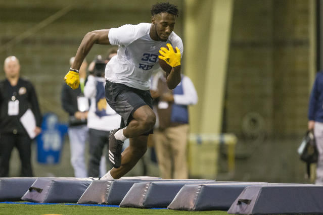 Josh Adams runs drills during Notre Dame Pro Day football workouts in South Bend, Ind., Thursday, March 22, 2018. (Michael Caterina/South Bend Tribune via AP)