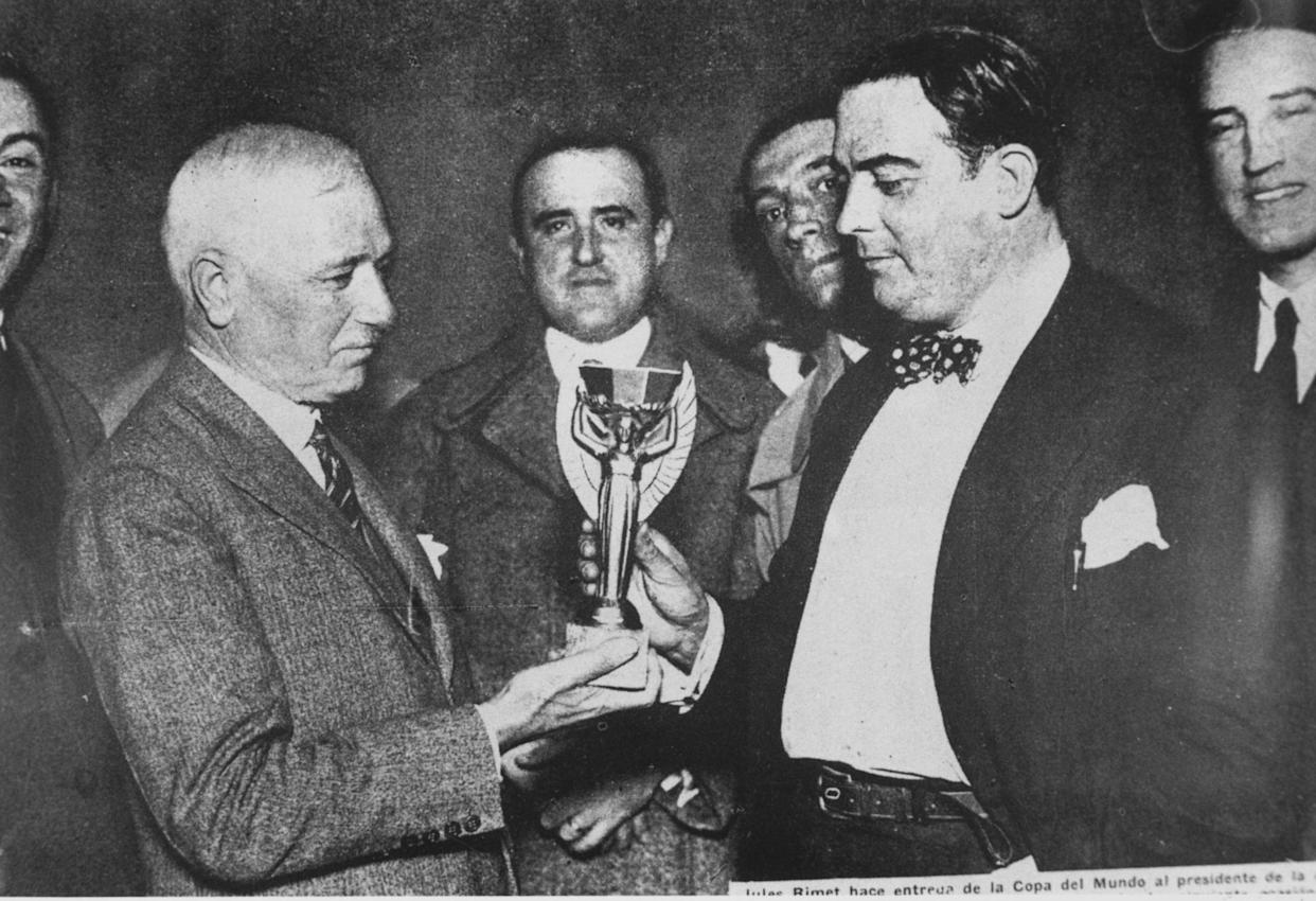 Jules Rimet (left) president of FIFA, presents the first World Cup trophy (the Jules Rimet Trophy) to Dr Paul Jude, the president of the Uruguayan Football Association, after Uruguay beat Argentina 4-2 in the first ever World Cup final in 1930. (Getty)