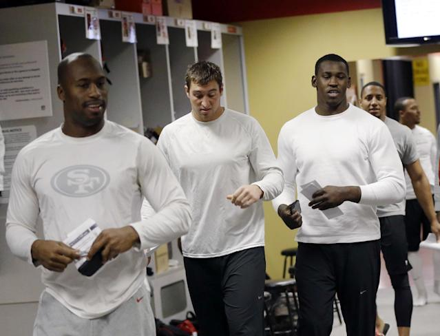 San Francisco 49ers linebacker Aldon Smith, third from left, joins teammates in the locker room in the team's NFL football practice facility, Tuesday, Nov. 5, 2013, in Santa Clara, Calif. Smith missed the past five games while undergoing treatment for substance abuse. (AP Photo/Marcio Jose Sanchez)