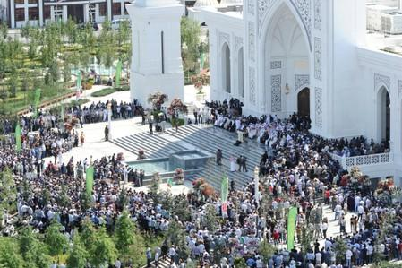 People gather near a new mosque during an inauguration ceremony in Shali