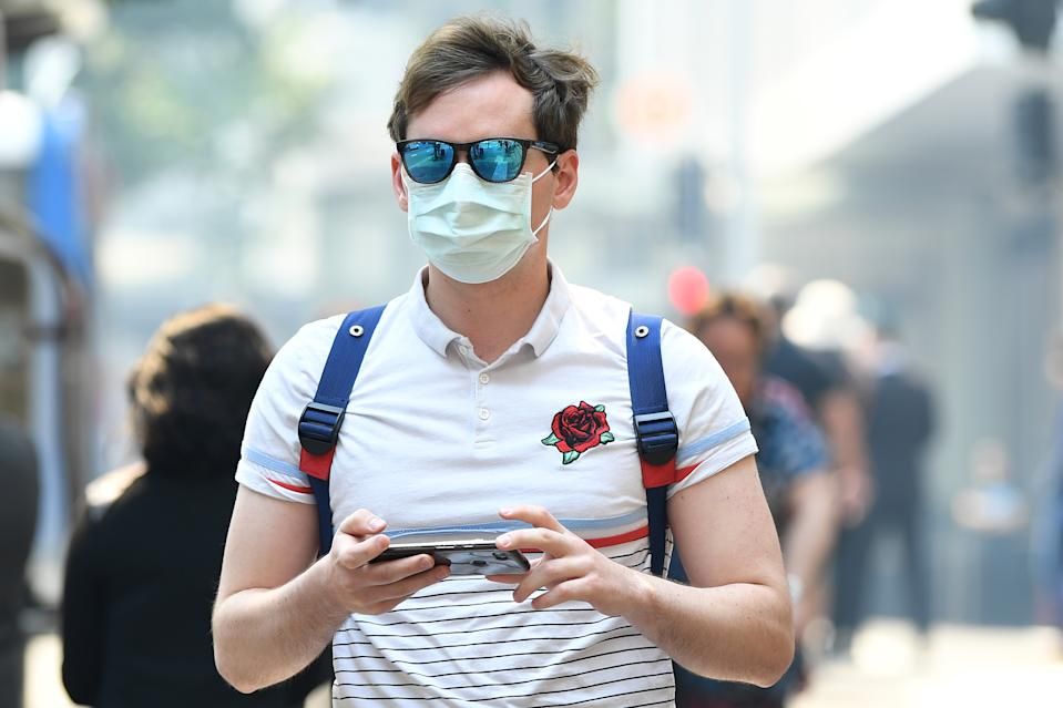 A man wearing a mask in Sydney on Tuesday. Source: AAP