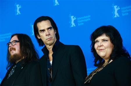 """Directors Ian Forsyth and Jane Pollard pose with cast member Nick Cave during a photocall promoting the movie """"20,000 Days on Earth"""" at the 64th Berlinale International Film Festival in Berlin"""