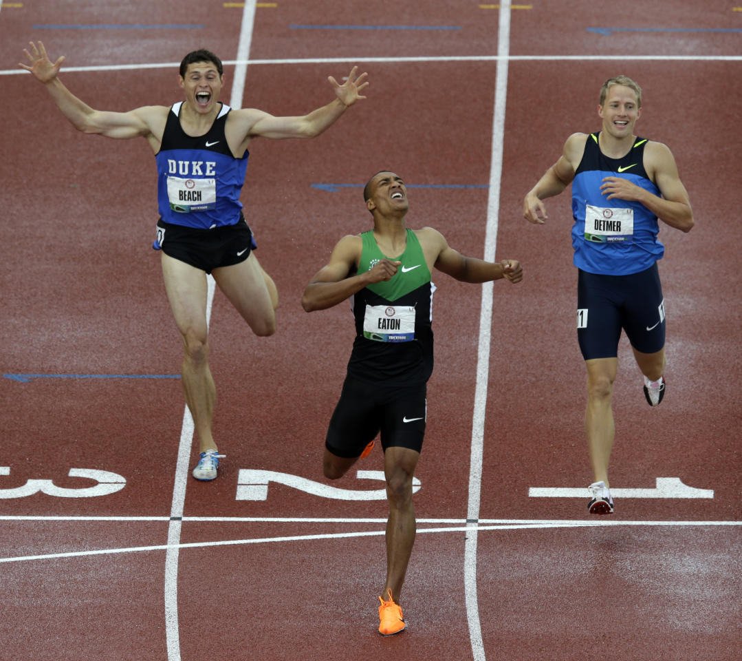 Ashton Eaton reacts with Curtis Beach and Joe Detmer after the 1500m during the decathlon competition at the U.S. Olympic Track and Field Trials Saturday, June 23, 2012, in Eugene, Ore. Eaton finished the decathlon with a new world record. (AP Photo/Charlie Riedel)