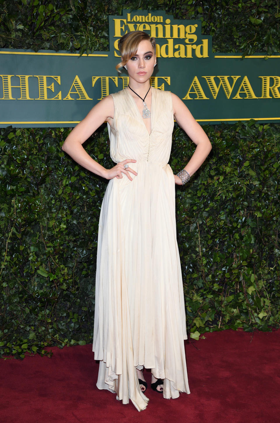 <p>Suki chose a cream vintage-inspired gown accompanied by lots and lots of diamonds. <i>[Photo: Getty]</i> </p>