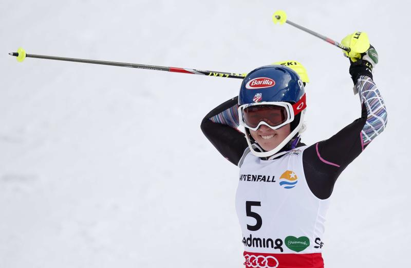 United States' MikaelaShiffrin celebrates winning the gold medal after the second run of the women's slalom at the Alpine skiing world championships in Schladming, Austria, Saturday, Feb.16,2013. (AP Photo/Matthias Schrader)