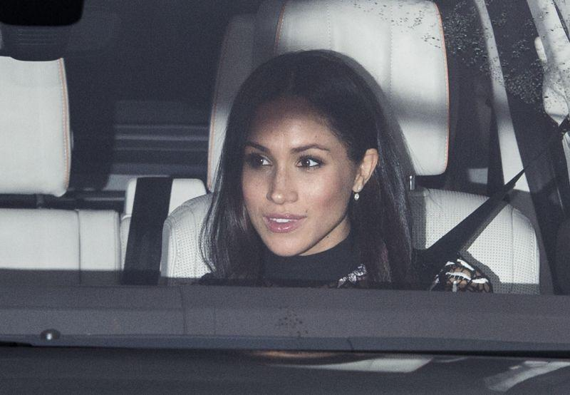 <p><strong>When: Dec. 20, 2017</strong><br>Meghan Markle was photographed being driven by fiancee Prince Harry to Buckingham Palace to meet the entire royal family at the Queen's Christmas lunch.The 36-year-old kept her hair down and complemented the look with gorgeous diamond drop earrings. <em>(Photo: Getty)</em> </p>