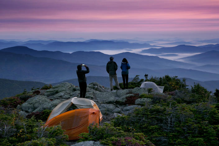 Backpackers at their campsite just before sunrise on the Appalachian Trail in Beans Purchase Township, N.H. (Photo: Robert F. Bukaty/AP)