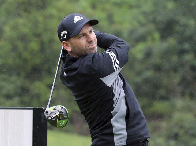 Sergio Garcia, of Spain, drives on the second tee in the rain in the Pro-Am round of the Genesis Open golf tournament at Riviera Country Club in the Pacific Palisades area of Los Angeles Wednesday, Feb. 13, 2019. Garcia is playing for the first time since he was disqualified for damaging greens at the Saudi International on Feb. 2. (AP Photo/Reed Saxon)