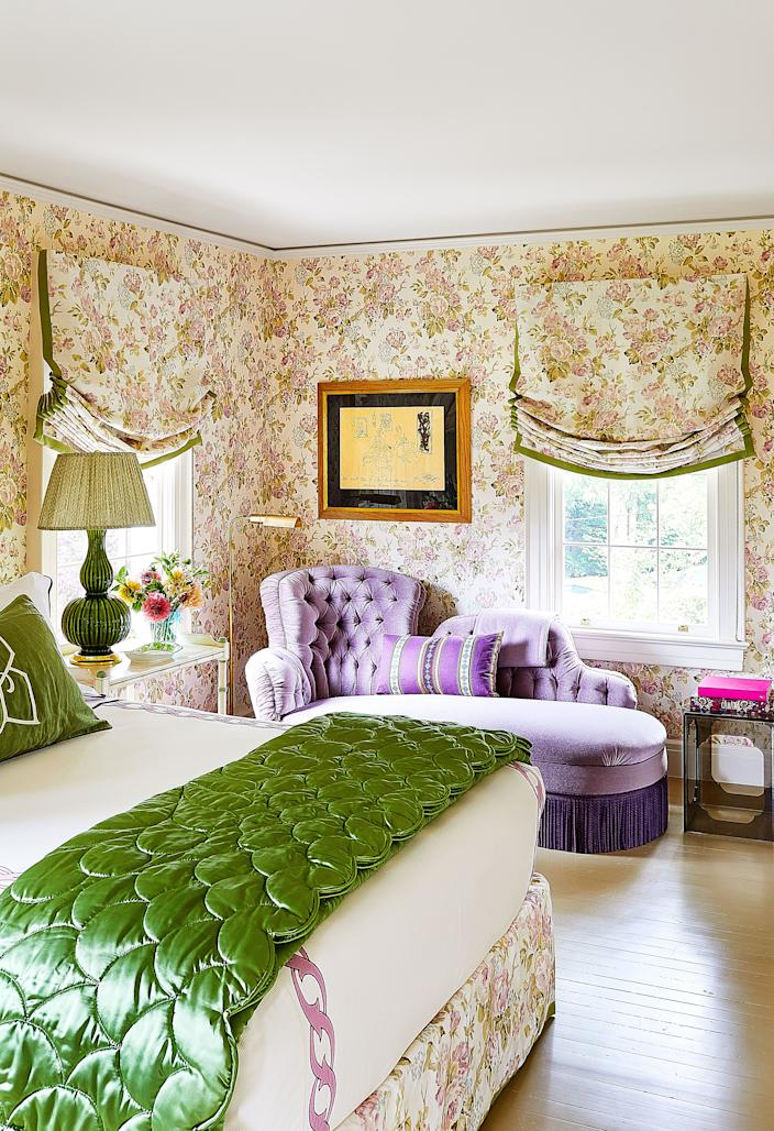 """<div class=""""caption""""> A guest bedroom features an heirloom chaise re-covered in a <a href=""""https://www.kravet.com/"""" rel=""""nofollow noopener"""" target=""""_blank"""" data-ylk=""""slk:Suzanne Rheinstein for Lee Jofa"""" class=""""link rapid-noclick-resp"""">Suzanne Rheinstein for Lee Jofa</a> mohair while the bed skirt, walls, and shades are all made of a <a href=""""https://www.kravet.com/"""" rel=""""nofollow noopener"""" target=""""_blank"""" data-ylk=""""slk:Suzanne Rheinstein for Lee Jofa"""" class=""""link rapid-noclick-resp"""">Suzanne Rheinstein for Lee Jofa</a> linen. Bed linens and satin quilt by <a href=""""https://leontinelinens.com/"""" rel=""""nofollow noopener"""" target=""""_blank"""" data-ylk=""""slk:Leontine Linens"""" class=""""link rapid-noclick-resp"""">Leontine Linens</a>. </div>"""