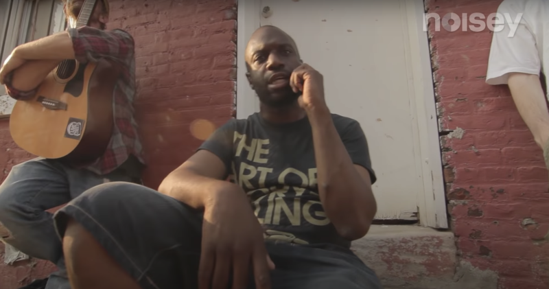 Malik B. pictured in a 2012 music video with Mr Green.