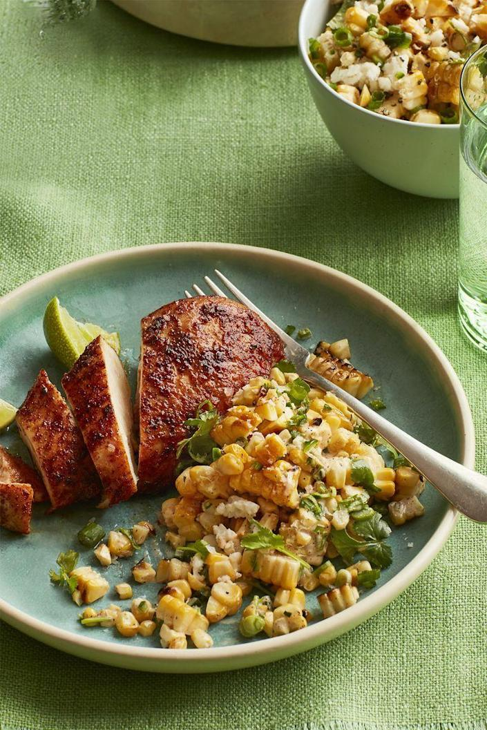 """<p>This corn salad is bright, vibrant, and pairs great with chipotle chili chicken.</p><p><em><strong><a href=""""https://www.womansday.com/food-recipes/food-drinks/recipes/a59416/smoky-chicken-charred-corn-salad-recipe/"""" rel=""""nofollow noopener"""" target=""""_blank"""" data-ylk=""""slk:Get the recipe for Smoky Chicken With Charred Corn Salad."""" class=""""link rapid-noclick-resp"""">Get the recipe for Smoky Chicken With Charred Corn Salad.</a></strong></em></p>"""