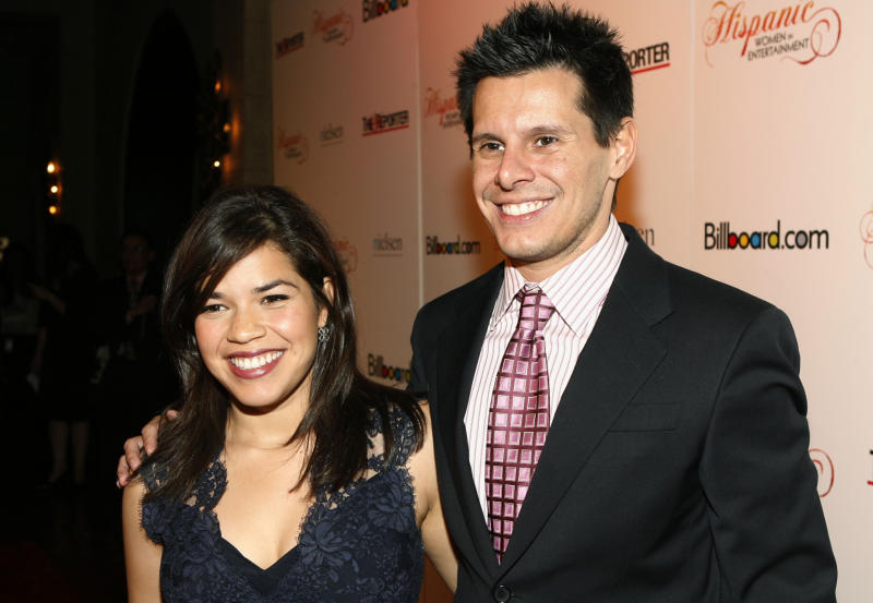"FILE - This Oct. 9, 2007 file photo shows ""Ugly Betty"" actress America Ferrera, left, and show creator Silvio Horta at the Billboard magazine Hispanic Women in Entertainment breakfast in Los Angeles, where Ferrera received the Hispanic Woman of the Year award. Horta died in Miami on Tuesday, Jan. 8, 2020. He was 45. (AP Photo/Matt Sayles, File)"