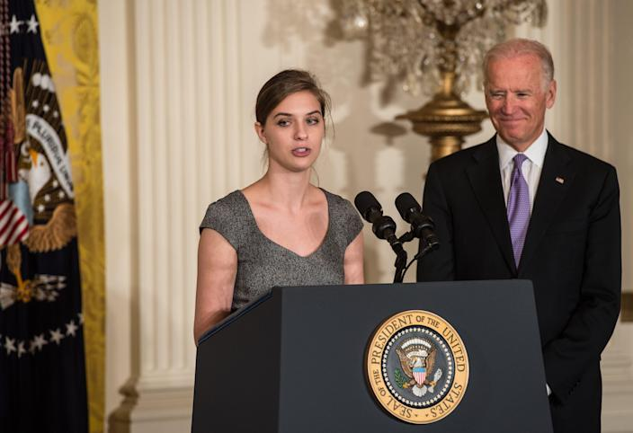 "US Vice President Joe Biden looks on as rape victim Lilly Jay speaks at the launch of the ""It's On Us"" campaign to prevent sexual assault on college campuses at the White House in Washington on September 19, 2014 (AFP Photo/Nicholas Kamm)"