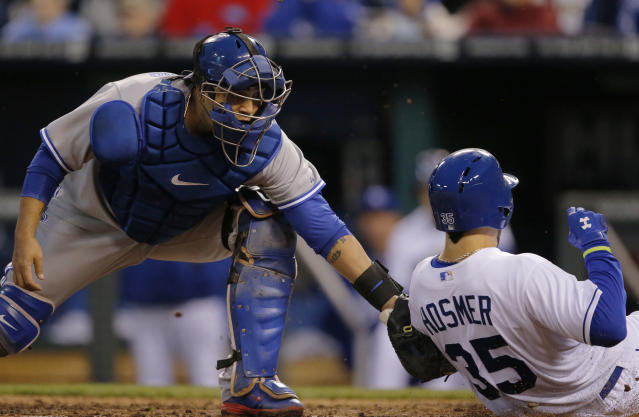 Toronto Blue Jays catcher Dioner Navarro, left, tags out Kansas City Royals' Eric Hosmer (35) during the fourth inning of a baseball game at Kauffman Stadium in Kansas City, Mo., Wednesday, April 30, 2014. (AP Photo/Orlin Wagner)