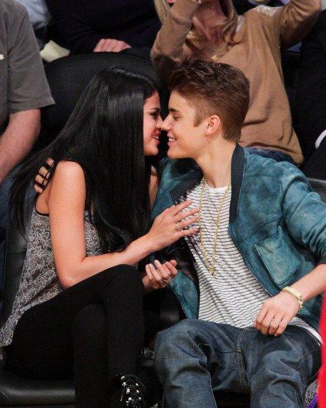 Succumbing to the roaring crowd, the pop star couple leaned in for a proper kiss (Bieber much more than Gomez we're told!). Can Selena look any more unenthused? The moment was the complete opposite of a previous date at Staples Center, where it was rumored that Bieber had reserved the entire stadium for dinner and a movie with just the two of them!