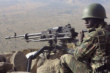A Cameroonian soldier guards at an observation post on a hill in the Mandara Mountain chain in Mabass overlooking Nigeria, northern Cameroon