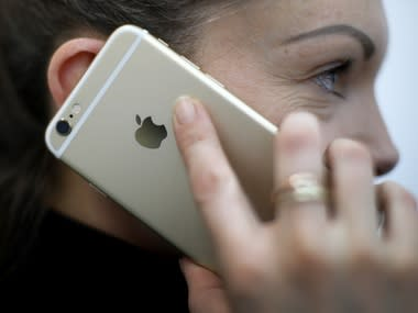 A woman uses her Apple iPhone 6. Image: Reuters