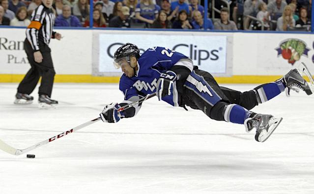 Tampa Bay Lightning right wing J.T. Brown falls forward toward the net after being hooked by New Jersey Devils defenseman Jon Merrill during the second period of an NHL hockey game Saturday, March 15, 2014, in Tampa, Fla. (AP Photo/Brian Blanco)