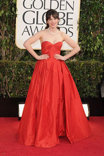 Zooey Deschanel: This red Oscar de la Renta is just not working. The taffeta is wrinkling and looks too heavy on the petite 'New Girl' star. (Photo by Steve Granitz/WireImage)