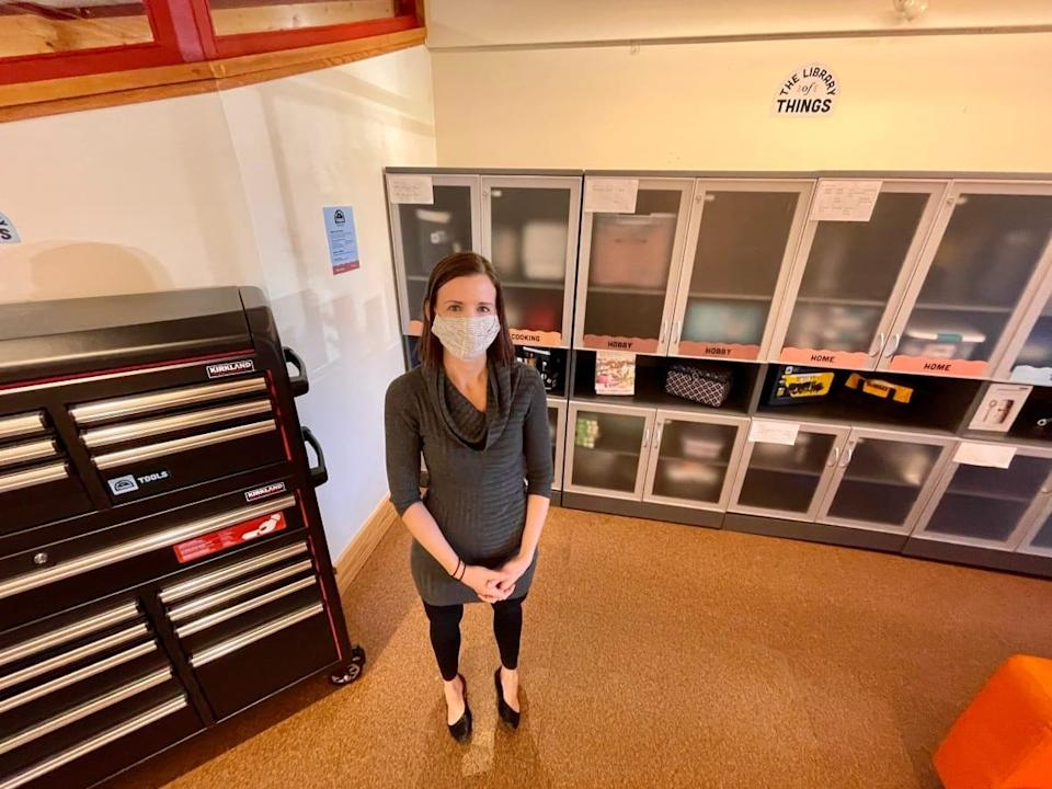 Banff Public Library director Sarah McCormack stands in front of the library's new initiative, which allows people to borrow objects from tools to kitchen appliances.  (Evelyne Asselin/Radio-Canada - image credit)