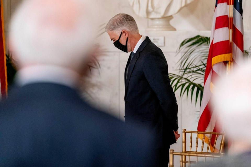 <p>U.S. Supreme Court Justice Neil Gorsuch departs following a private ceremony for Associate Justice Ruth Bader Ginsburg at the U.S. Supreme Court on September 23, 2020 in Washington, DC.</p>