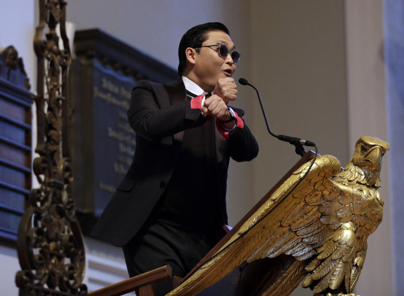 Korean pop star PSY speaks in Memorial Church at Harvard University in Cambridge, Mass., Thursday, May 9, 2013. Dozens of screaming and shouting Harvard University students welcomed South Korean pop star PSY for a conversation inside the ornate church dedicated to the memory of those who lost their lives in World War I. (AP Photo/Elise Amendola)