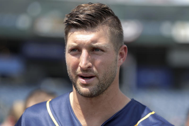 Tim Tebow talks to reporters during a news conference prior to the Eastern League All-Star minor league baseball game, Wednesday, July 11, 2018, in Trenton, N.J. (AP Photo/Julio Cortez)