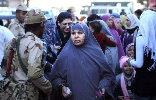 Egyptian women queue for the second round of a vote on a new constitution in Giza, Egypt, on December 22, 2012