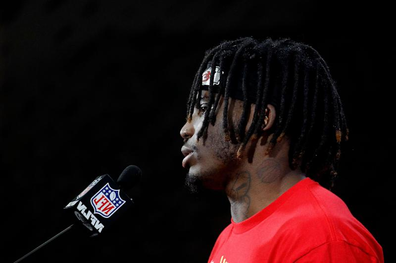 Refected in a mirror, Kansas City Chiefs wide receiver Tyreek Hill talks to the media after a workout Friday, Jan. 18, 2019, in Kansas City, Mo. The Chiefs host the New England Patriots in the NFL 's AFC football championship game on Sunday. (AP Photo/Charlie Riedel)