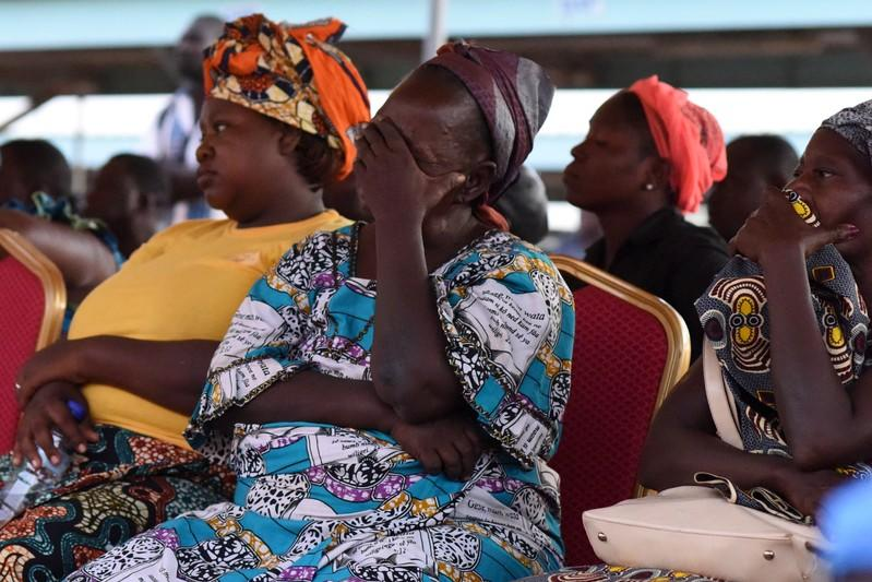 Family members of victims of an ambush on workers near a Canadian-owned mine, react during their meeting with officials in Ouagadougou