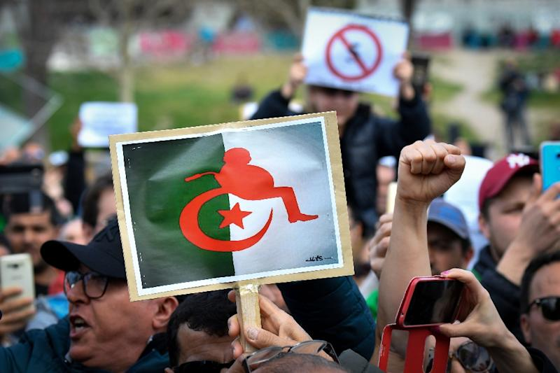 Protesters hold placards against the Algerian president's bid for a fifth term at a demonstration in the French city of Marseille (AFP Photo/GERARD JULIEN)