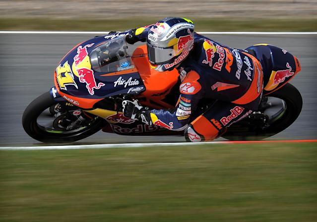 Red Bull KTM Ajo's German Sandro Cortese rides during the Moto3 race of the Catalunya Moto GP Grand Prix at the Catalunya racetrack in Montmelo, near Barcelona, on June 3, 2012. Blusens Avintia's Spanish Maverick Vinales won the race ahead of Red Bull KTM Ajo's German Sandro Cortese and Estrella Galicia's Portuguese Miguel Oliveira. AFP PHOTO / LLUIS GENELLUIS GENE/AFP/GettyImages