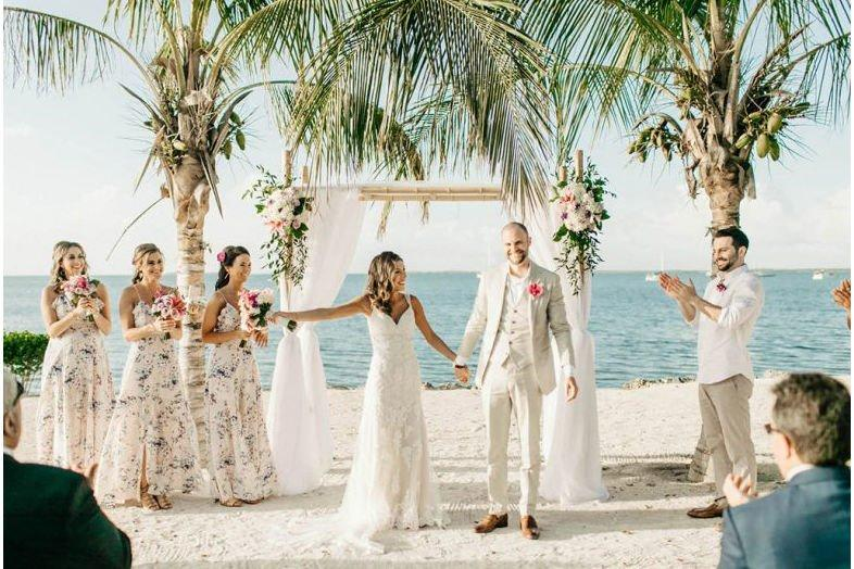 """<p><a href=""""https://www.keylargolighthouse.com"""" target=""""_blank"""">Key Largo Lighthouse Beach</a> offers couples a customizable package that includes all the wedding events of your choosing (welcome party, rehearsal dinner, wedding, reception), and accommodations for up to 24 guests in a beach house and guest house on the property. Two venue options, Hidden Beach and Coral Beach, offer picturesque settings for exchanging vows while the sun sets behind you. Then you can dance the night away on the white-sand beaches studded with majestic palm trees.</p>"""
