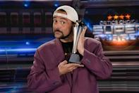 <p>Kevin Smith, who will share hosting duties for the Critics' Choice Super Awards, posed with the award in Los Angeles.</p>