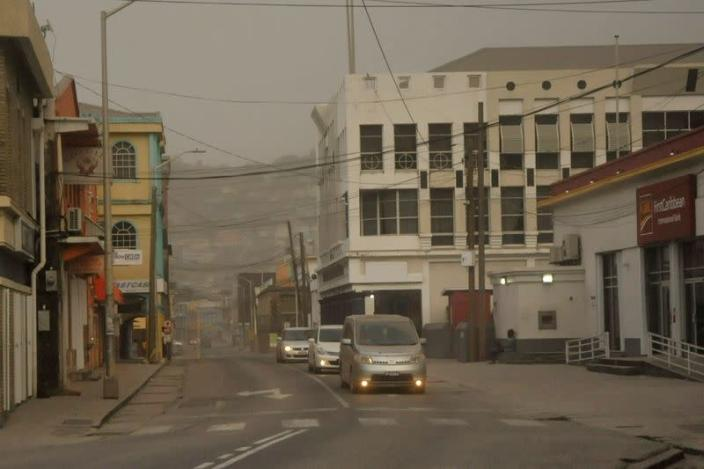Ash covers roads a day after the La Soufriere volcano erupted after decades of inactivity in St Vincent and the Grenadines