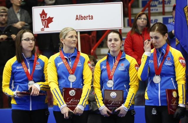 Alberta skip Val Sweeting (L-R) third Lori Olson-Johns, second Dana Ferguson and lead Rachelle Brown receive their silver medal after they lost their gold medal game to Manitoba during the Scotties Tournament of Hearts in Moose Jaw, Saskatchewan, February 22, 2015. REUTERS/Todd Korol (CANADA - Tags: SPORT CURLING)