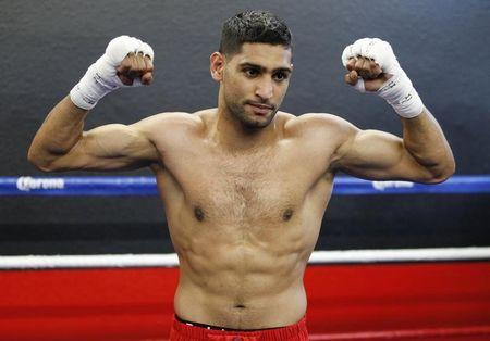 British boxer Amir Khan poses during a media opportunity at Ponce De Leon Boxing Club in Montebello