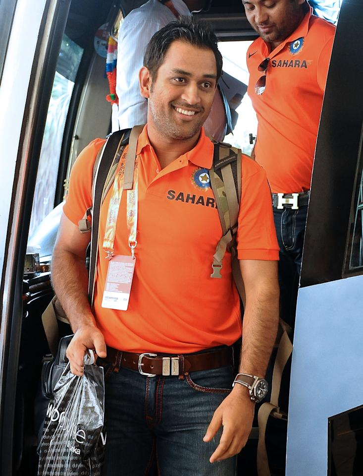 Indian cricket captain  Mahendra Singh Dhoni arrives with his team for the World Cup Twenty20 tournament in Colombo on September 12, 2012. The two-yearly tournament in cricket's shortest format will be played from September 18 to October 7, with Hambantota holding three matches, Pallekele nine and capital Colombo fifteen.  AFP PHOTO/ LAKRUWAN WANNIARACHCHI