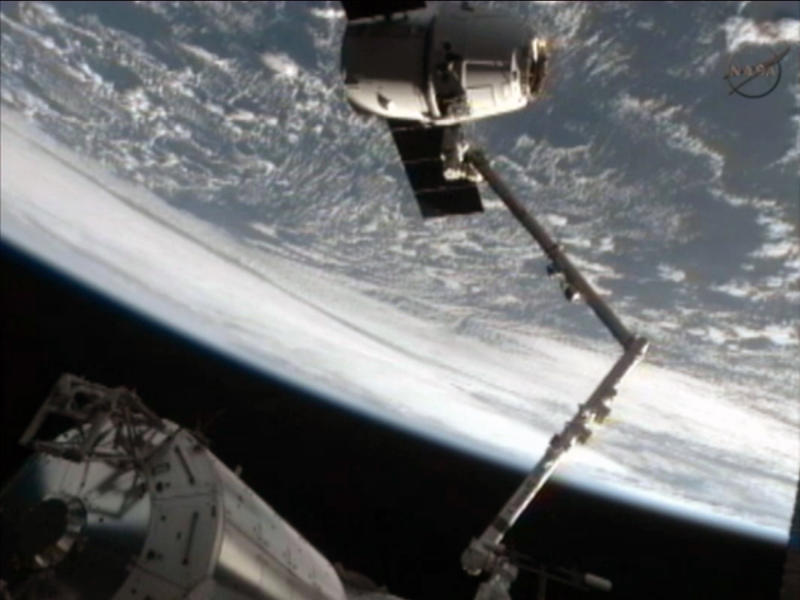 This framegrab image from NASA-TV shows the SpaceX Dragon capsule just after the capsule is released from the Canadarm2 at 5:49 a.m. EDT Thursday morning May 31, 2012. The Dragon capsule is scheduled for splashdown at 11:44 a.m. EDT Thursday in the Pacific Ocean. (AP Photo/NASA)