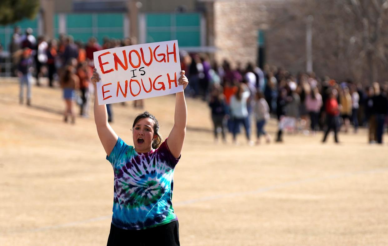 Columbine High School student Leah Zunder holds a sign.