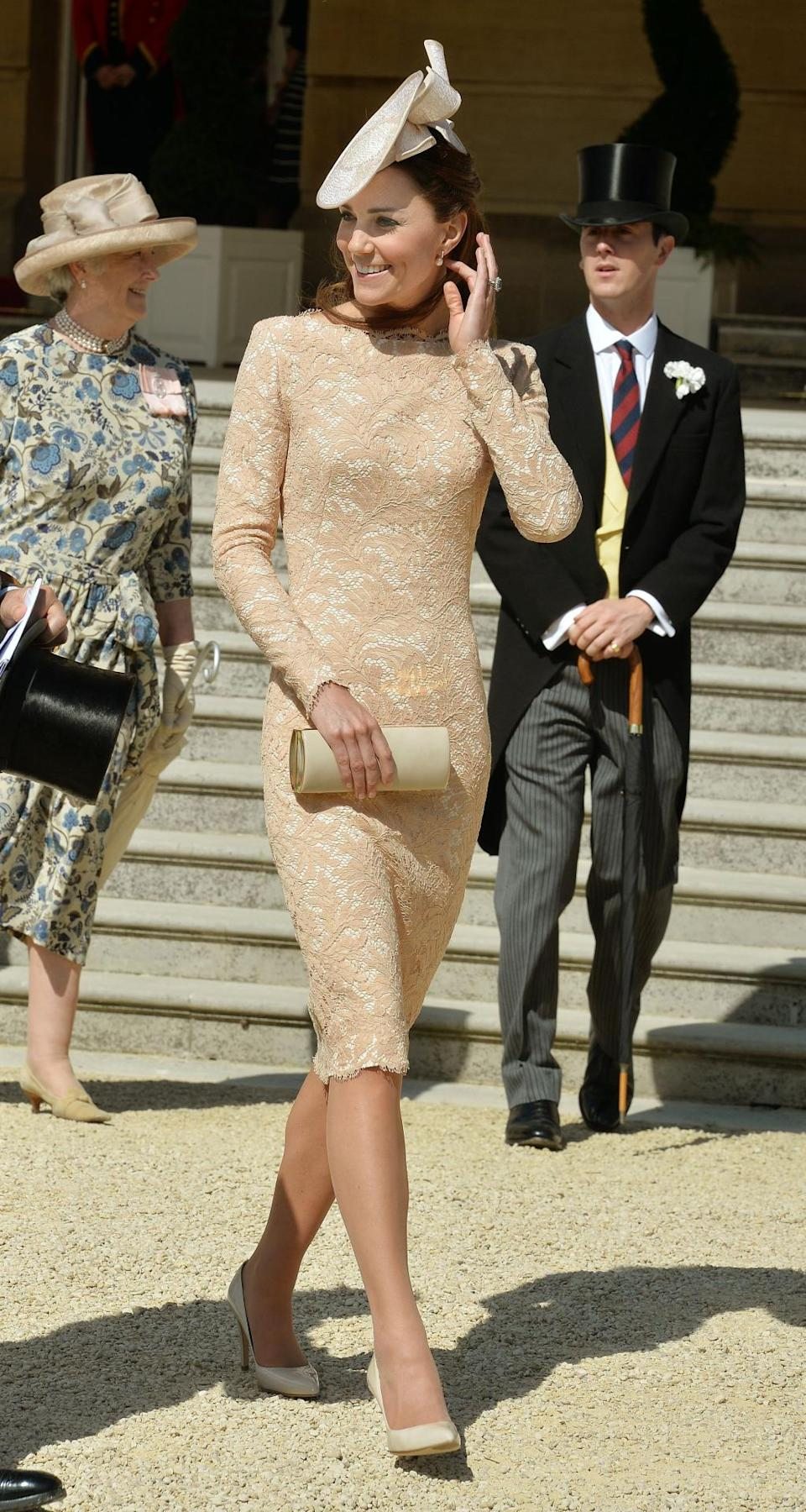 <p>The Duchess stunned in a bespoke nude dress by Alexander McQueen for Buckingham Palace's garden party. Kate accessorised with a coordinating hat by Jane Corbett and nude heels by Russell and Bromley. </p><p><i>[Photo: PA]</i></p>
