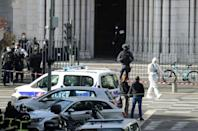 French police at the Basilica of Notre-Dame de Nice in southern France on Thursday, when a knifeman killed three people.