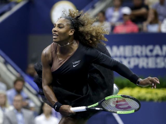 Serena Williams serves to Naomi Osaka, of Japan, during the women's final of the U.S. Open tennis tournament, Saturday, Sept. 8, 2018, in New York. (AP Photo/Julio Cortez)