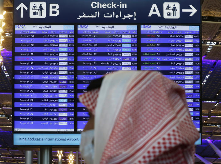 A screen displays local and international departures at King Abdulaziz International Airport in Jiddah, Saudi Arabia, Monday, May 17, 2021. Vaccinated Saudis will be allowed to leave the kingdom for the first time in more than a year as the country eases a ban on international travel that had been in place to try and contain the spread of the coronavirus and its new variants. (AP Photo/Amr Nabil)