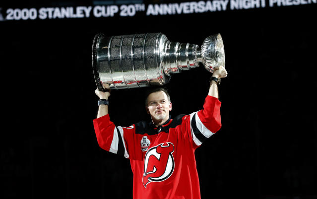 Former New Jersey Devils player Petr Sykora stands on the ice during a ceremony to honor the 2000 Stanley Cup team Saturday, Feb. 1, 2020, in Newark, N.J. (AP Photo/Noah K. Murray)